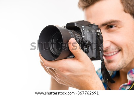 Portrait of young smiling man taking photo