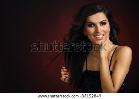 Portrait of young smiling party girl - stock photo