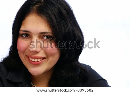Portrait of young, smiling seventeen year old girl with black hair on white background - stock photo