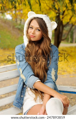 Portrait of young smiling woman dressed in cute hat with ears. - stock photo