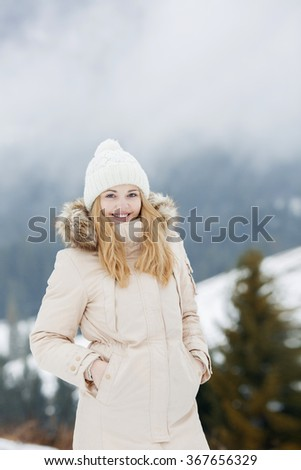 Portrait of young smiling woman of the mountains  - stock photo