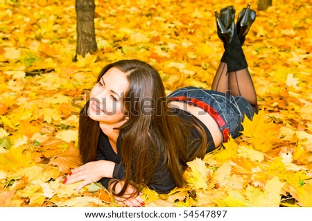 portrait of young smiling woman on the leaves
