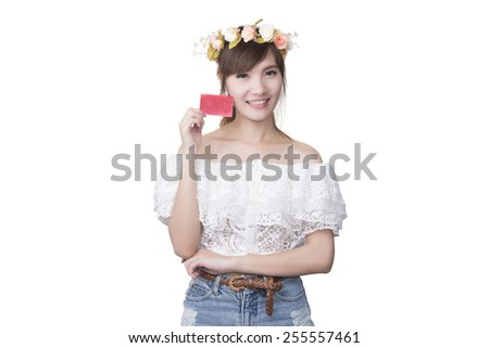 portrait of young smiling women holding credit card