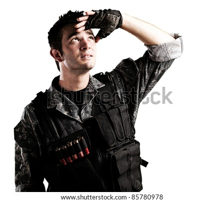 portrait of young soldier handsome looking up against a white background - stock photo