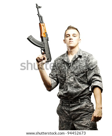 portrait of young soldier holding rifle wearing urban camouflage over white background - stock photo