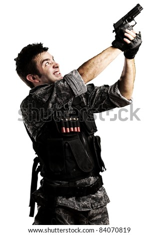 portrait of young soldier shooting with a gun against a white background - stock photo