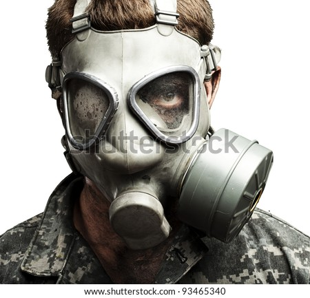 portrait of young soldier wearing gas mask against a white background
