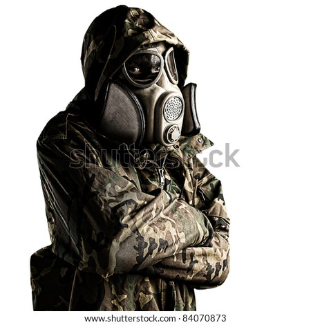 portrait of young soldier with mask against a white background - stock photo