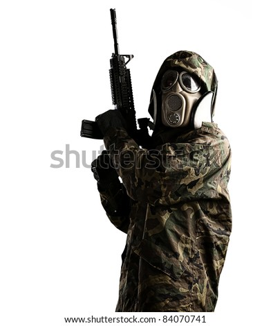 portrait of young soldier with rifle and gas mask against a white background