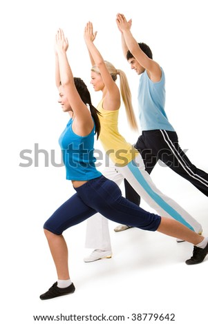 Portrait of young sporty people doing physical exercise altogether