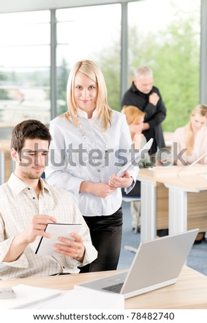 Portrait of young student businesspeople in office having meeting - stock photo