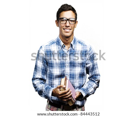 portrait of young student holding books and smiling against a white background