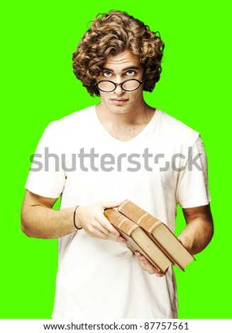 portrait of young student holding books over a removable chroma key background - stock photo