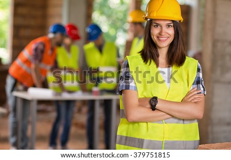 Portrait of young student of architecture on construction site - stock photo