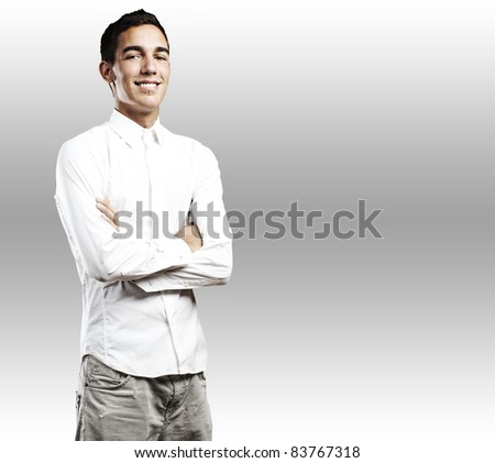 portrait of young student smiling with shirt against a white background - stock photo