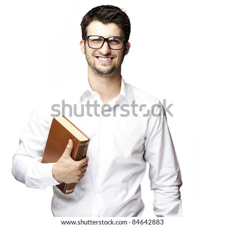 portrait of young student with glasses holding a book against a white background