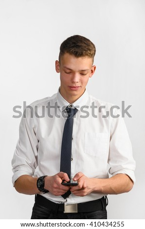 portrait of young stylish businessman on gray background - stock photo