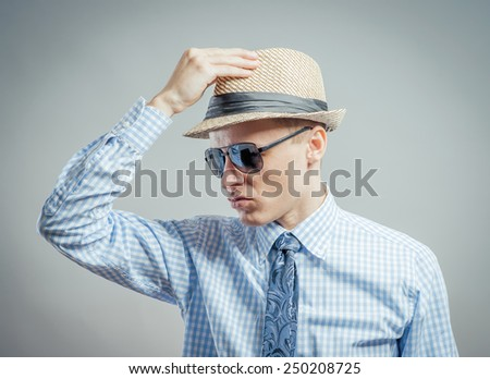 portrait of young stylish guy with hat and sunglasses.