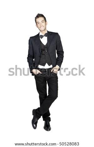 Portrait of young stylish man in tuxedo, studio shot isolated on white background - stock photo