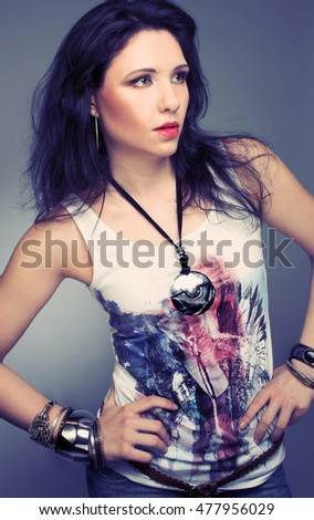 Portrait of young stylish woman with dark hair