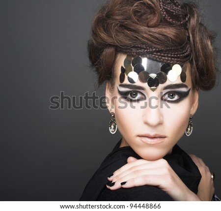 Portrait of young stylisn woman with creative visage. - stock photo