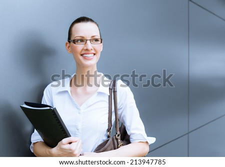 Portrait of young successful businesswoman. - stock photo
