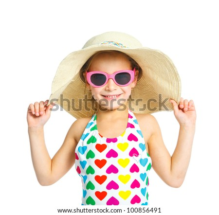 Portrait of young summer girl smiling in multi-colored swimsuit, glassis and beach hat. Isolated on white background. - stock photo