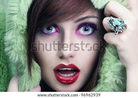 Portrait of young surprised girl holding her face - stock photo