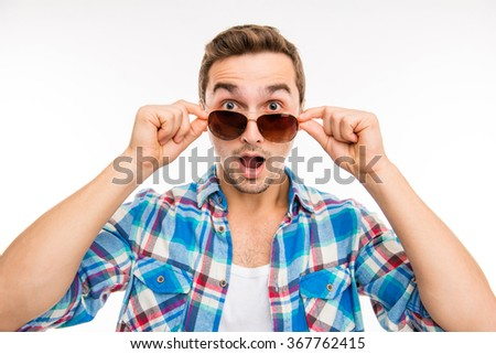 portrait of young surprised man in glasses - stock photo