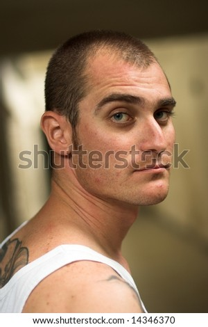 Portrait of young tattooed man - stock photo