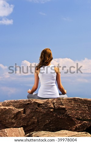 Portrait of young teenage girl doing yoga