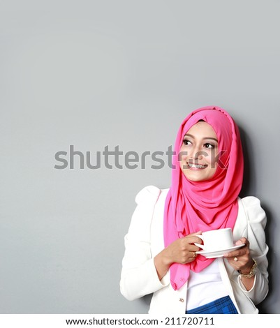 portrait of young thinking woman having a cup of tea - stock photo