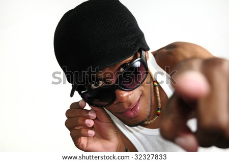 Portrait of young trendy african american male model pointing finger - stock photo