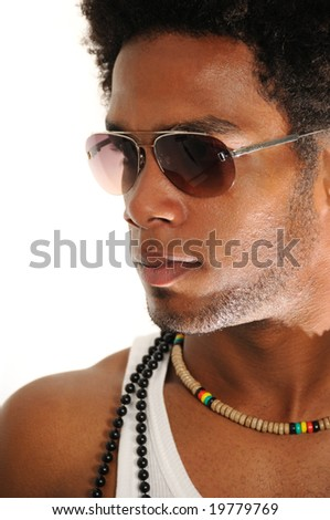 Portrait of young trendy african american man posing with sunglasses - stock photo