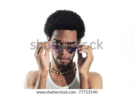 Portrait of young trendy african american man posing with sunglasses, isolated on white - stock photo