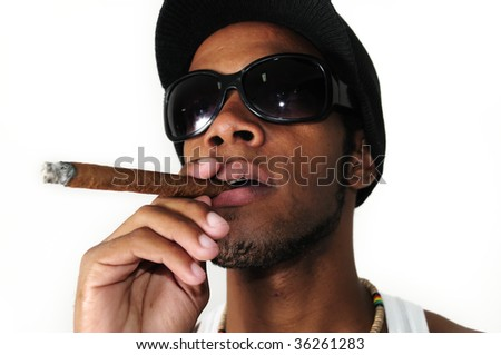 Portrait of young trendy african american man smoking a cigar - stock photo