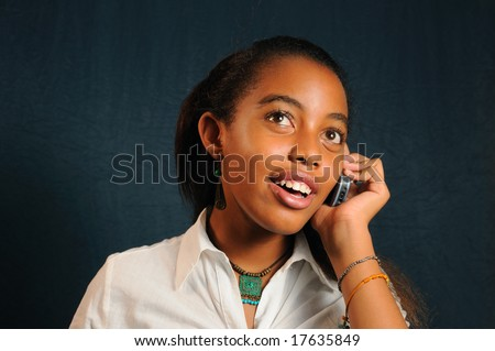 Portrait of young trendy african girl using a cell phone - stock photo