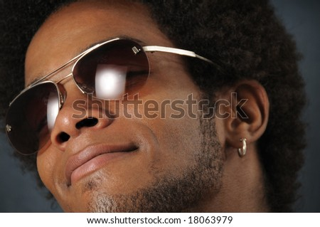 Portrait of young trendy african man wearing sunglasses - stock photo