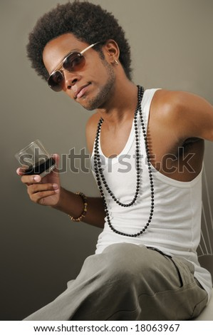 Portrait of young trendy african man with glass of liquor - stock photo