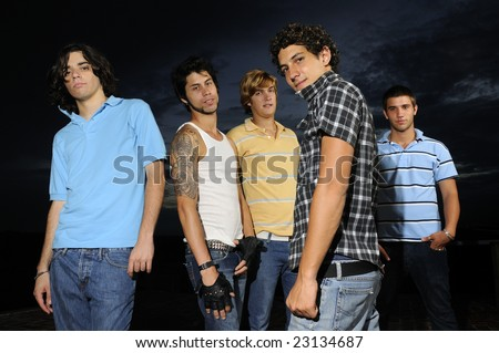 Portrait of young trendy group of friends standing with attitude - stock photo