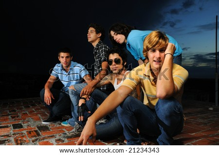 Portrait of young trendy group of male friends standing with attitude - stock photo