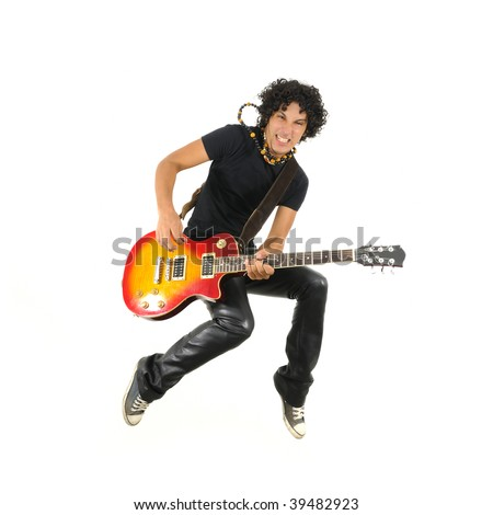 Portrait of young trendy guy jumping with electric guitar isolated on white - stock photo