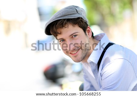 Portrait of young trendy guy standing outside - stock photo