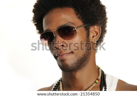Portrait of young trendy latino male wearing sunglasses - stock photo