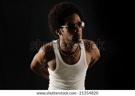 Portrait of young trendy latino man wearing sunglasses - stock photo