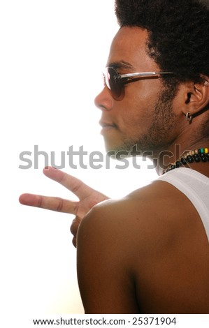 Portrait of young trendy latino man with attitude - stock photo