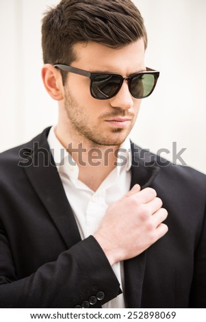 Portrait of young trendy man with black glasses. - stock photo
