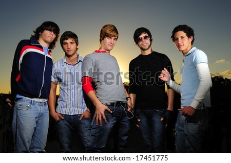 Portrait of young trendy teenager group posing - stock photo