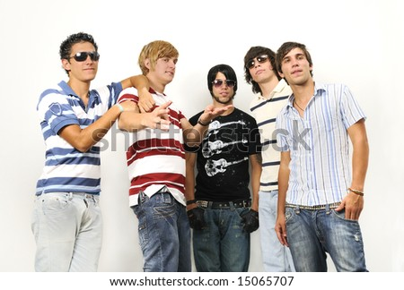 Portrait of young trendy teenager group standing isolated