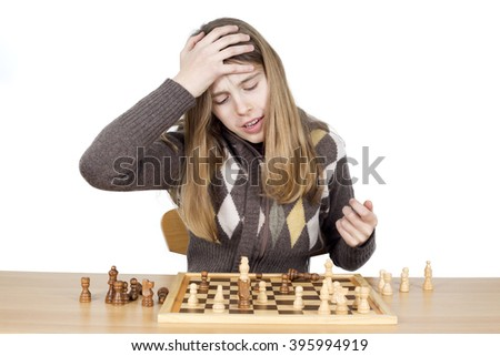 Portrait Of Young Very Disappointed Girl Slapping Hand On Head To Say Duh, Expressing Regret For Mistake She Made During The Chess Game, Studio Shot Isolated On White - stock photo